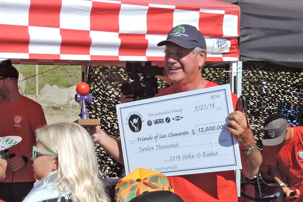 ... and accepts a check for $12,000 for the Friends of San Clemente.