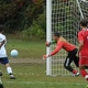 Sophomore keeper Rafael Perez dives for a loose ball.