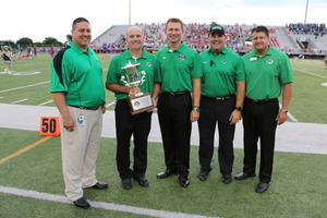 CSHS Principal Shawn Duhon center accepts Southlakes 3rd straight UIL Lone Star Cup during a ceremony before the football season opener at Dragon Stadium
