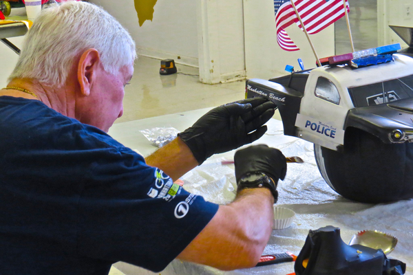 MBPD's Andy Harrod puts some nice touches on his department's pumpkin race entry.