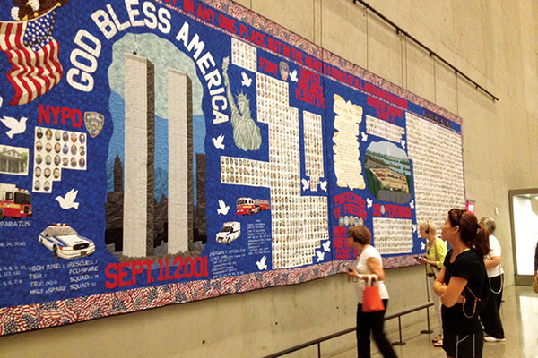 Visitors look at a quilt in the National 9/11 Memorial Museum at Ground Zero in Lower Manhattan.