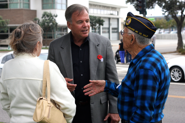 MB Mayor Pro Tem Mark Burton shakes the hand of a veteran after Tuesday's ceremony.
