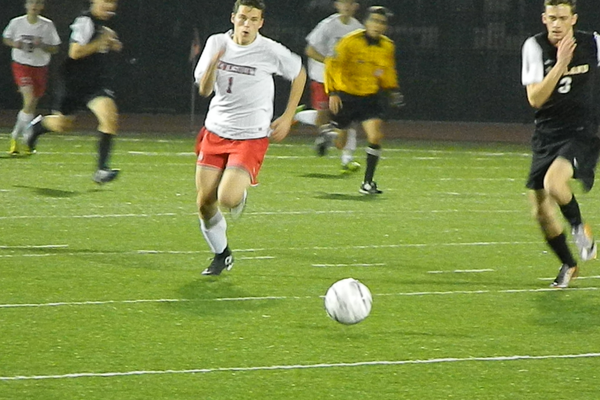 Junior forward Nick McKeon (1) chases down a through ball.