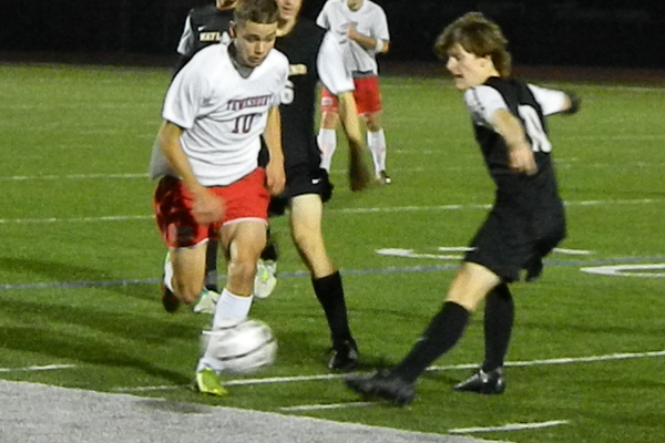 Senior forward Matt Lemos (10) battles for the ball against Wayland.