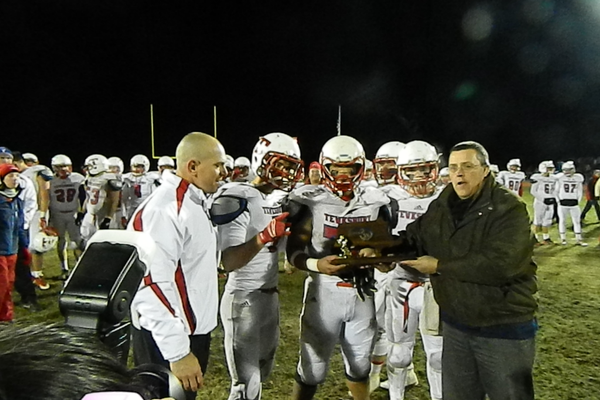 Tewksbury's captains and coaches accept the Division 3 Northeast Sectional trophy.