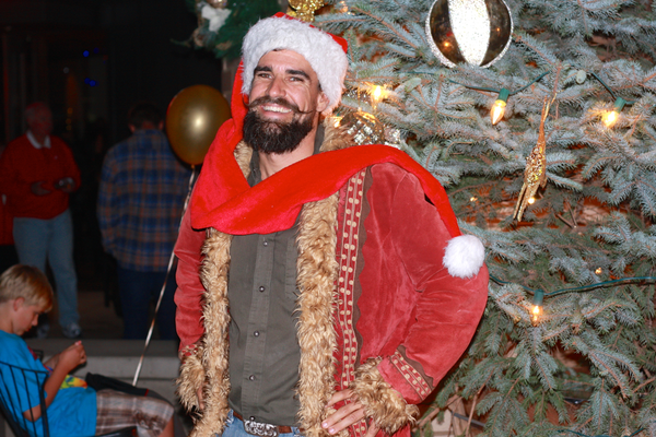 "Scott Martin, aka ""Scotty Claus"" of The Living Christmas Co. whose company was featured on the TV show ""Shark Tank,"" poses in front of a gorgeous living Christmas tree in Metlox Plaza."