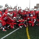 Winning smiles -- Tewksbury players pose with their trophy after beating Wilmington