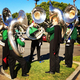 Tubas in the Mira Costa Marching Band warm up for the parade