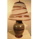 A pottery lamp base with a glass shade by Kevin Lehman.