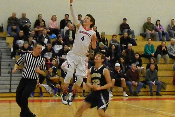 Nate Tenaglia (4) scores two of his 19 points against Windham.
