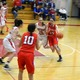 Molly Robertson (23) drives to the basket.