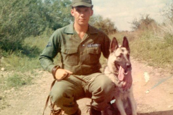 Robert Preston training as a K-9 handler in Texas. He brought this photo to his Listening Station session.
