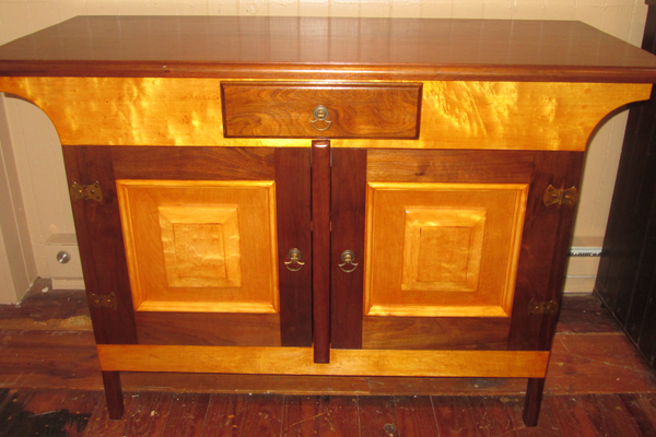 A sideboard built by Hugh out of contrasting types of wood.