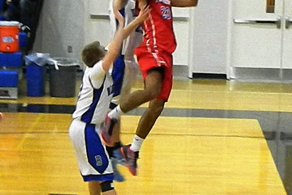 Adam Gajjaoui (23) owned the backboards in the second half against Bedford.