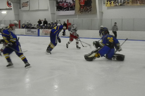 Ryan Petti (8) scores one of his two goals against Acton-Boxboro.
