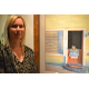 "Artist Kathy Bauer poses with ""Staycation"""