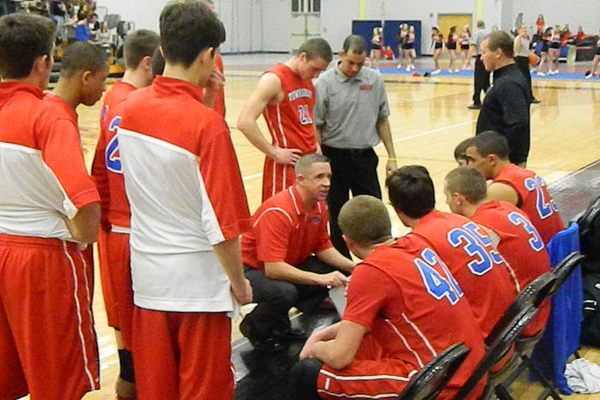 Head coach Phil Conners talks to his team during a second half time out.
