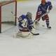 Senior goaltender Kyle Paquette makes a glove save against Billerica.