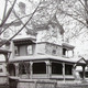 This postcard captures the stately trees along Cass Street, as well as this elaborate Victorian home.