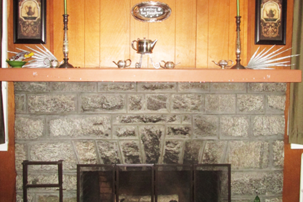 A fireplace in the front parlor.