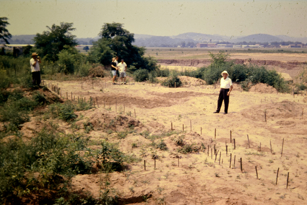 This circa-1964 photograph shows the excavators and guests at the Montoursville Boro site. Wooden stake markers are placed in many of the postmolds to outline the footprint of the Proto-Iroquoian longhouse. Photo courtesy of the Hutchinson Family.