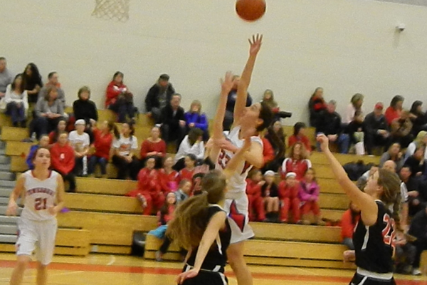 Molly Robertson (23) leaps high for a rebound against Marblehead.