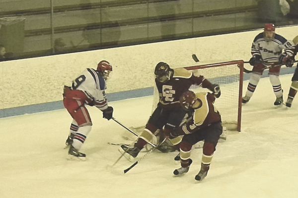 Patrick Leonard (9) tries to force it home.
