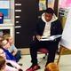 Jahad Thomas (from PA) reads Gertrude McFuzz to Ms. Selissen's class. Ryan Flynn & Olivia Millspaugh look on.