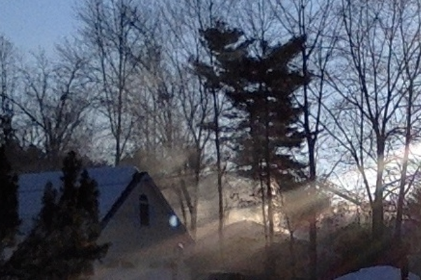 Tewksbury Firefighters battle a blaze at 85 Rounsevell Ave. on Monday.