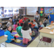 Samira Ahmed answers questions in Mrs. Wrobel and Mrs. Yore's second grade class. Samira is a former student of Mrs. Wrobel.