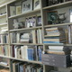 Wyeth's library shelves hold an array of art reference books and mementoes.