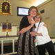 Avon Grove Nazarene Academy director Kathy St John left hugs Ann Marie Spencer after announcing her award