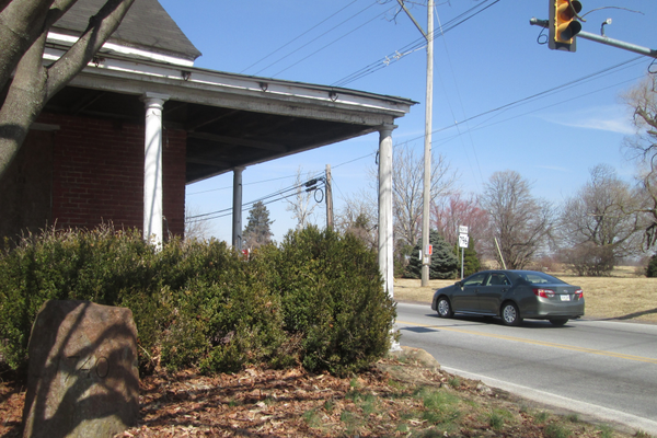 The Red Rose Inn's 1740 stone marker sits near the corner of Old Baltimore Pike and Jennersville Road.