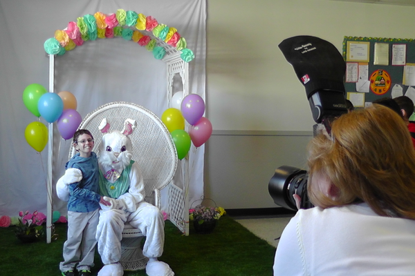 Jared Cohen poses with the Easter Bunny while EKG Photography takes his picture.