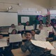Students in Mrs. Follett's third grade class show off their maps of Massachusetts. Students filled in key landmarks and learned locations in the Commonwealth relative to other locations- states, rivers, and land forms.