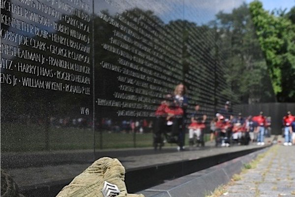 Tom's fatigue hat sits on the Vietnam Veterans Memorial Wall in D.C.