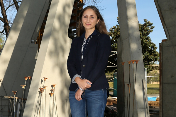 Marine Vardanyan, president of the Armenian student organization at Fresno State, in front of the Armenian Genocide Monument. The monument is the first of its kind to be built on a university campus in the U.S. It will be unveiled in a special ceremony on April 23.  Photo by Dan Minkler