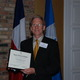Stephen Thornton , President of Westlake Historical Preservation Society receiving Historical Preservation Recogntion Award