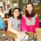 Tewksbury Congregational Church Youth, Lindsay Lombardo and Abby Hansbury, help sort cans at the Tewksbury Community Pantry during a Sunday School classroom field trip.
