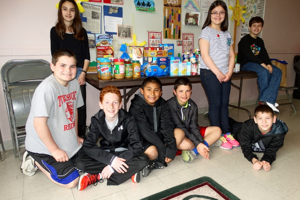 Youth from Tewksbury Congregational Church collect food in their 5th/6th Grade Classroom to bring to the Tewksbury Community Pantry.  Pictured L-R are Brianna Musgrave, Luke McFadyen, Travis Cohen, Will McFadyen, Jack Panilaitis, Lindsay Lombardo, Jason Barnes and Austin Bartnicki.