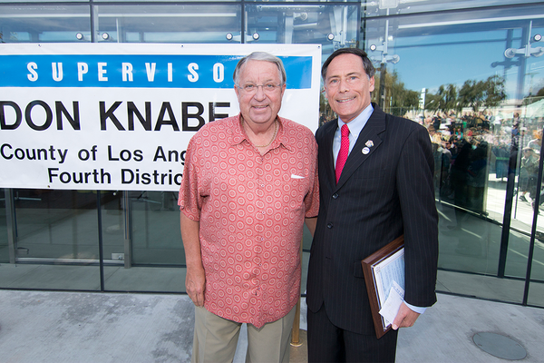 Supervisor Don Knabe and MB Mayor Wayne Powell outside the new library. Photo by Brad Jacobson.