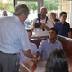 Senior leadership on the team meets with President George W. Bush. Photo courtesy of Jason Sykes.
