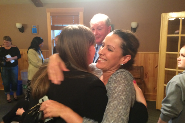 Newly elected School Committee member Jayne Miller is congratulated by a supporter.