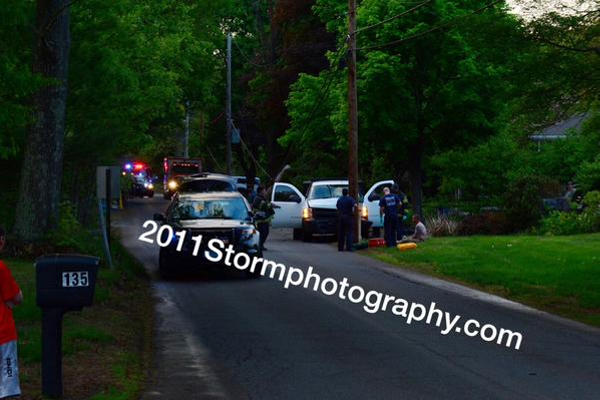 A vehicle driven by Matthew Mulvaney crashed into a utility pole on Lowe Street. Photo courtesy of Rich MacDonald.