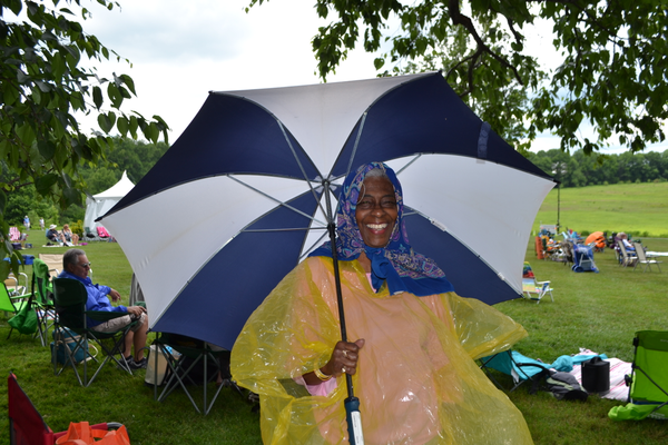 Betty Berry-Holmes of Wyncotte came prepared from the brief showers, which quickly turned into a beautiful afternoon.