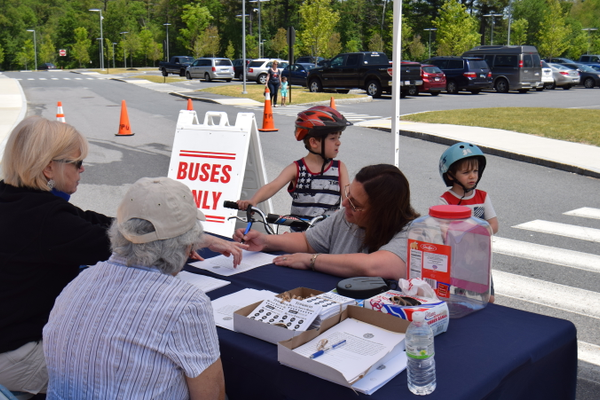Tewksbury residents Angela, Tommy & Timmy checking in at the Bike Rodeo.