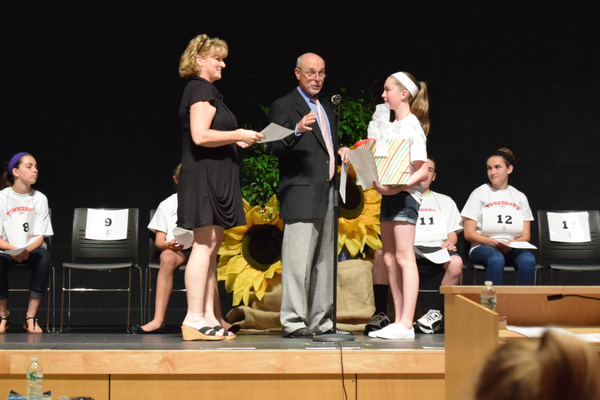 Wynn School's Meghan Ostertag won the TEF 7th Grade Spelling Bee. She is congratulated by Superintendent of Schools John O'Connor.