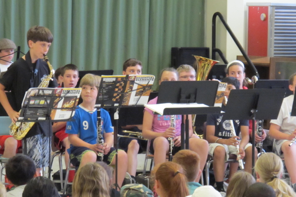 Fifth grader Alek Cranston demonstrates the alto saxophone during the Ryan School Band Tour.