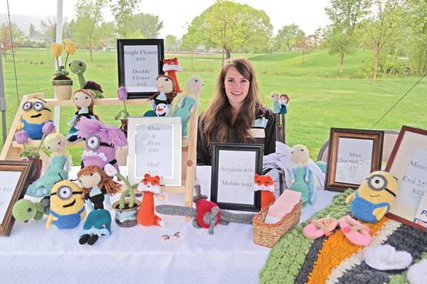 Mary Peterson and her hand crocheted baby wares.