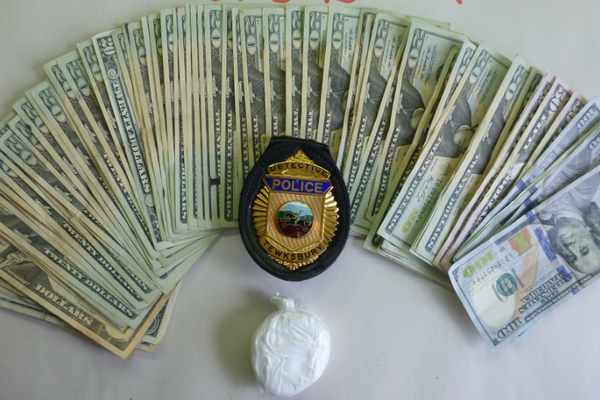 Cash and drugs were seized in the arrest of Juan Carlos  Delossantos.